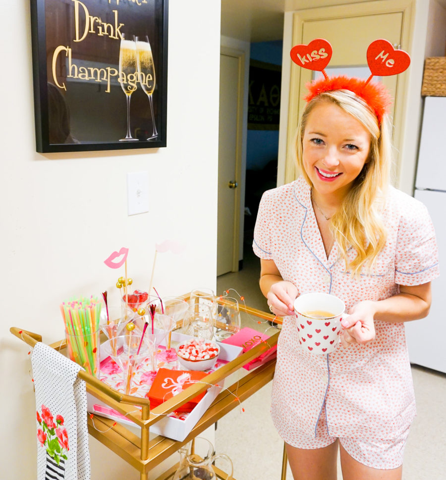 Amy from I Believe in Pink wearing Serena and Lily pajamas and styling a Valentine's Day bar cart.jpg