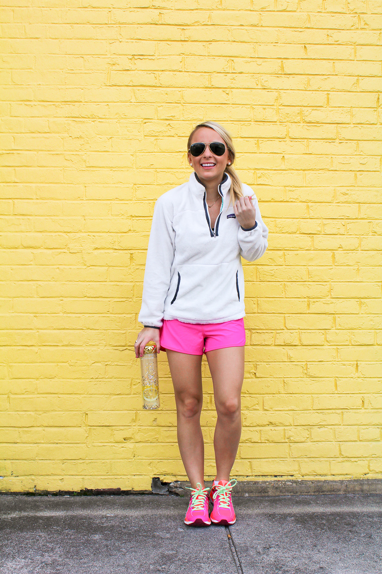 Amy from I Believe in Pink in Nike sneakers, lulu lemon shorts, and white Patagonia pullover-4