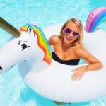Diff sunglasses, unicorn float, and Kate Spade bathingsuit