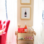 Gold bamboo bar card with pink and green banana leaf decorations in Philadelphia apartment