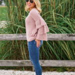 Blush ruffle Nordstrom sweater and bow booties with Lisi Lerch tassel earrings