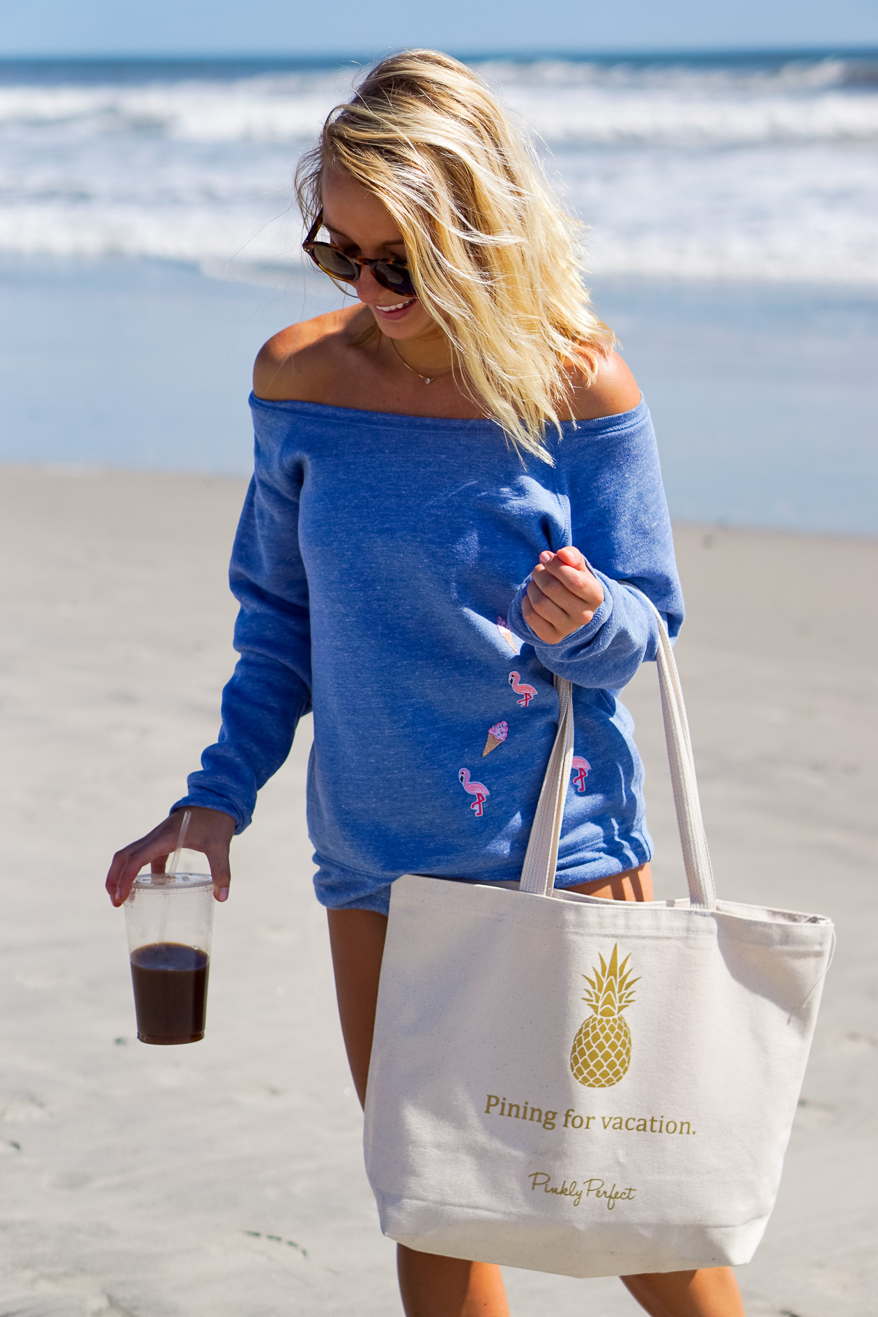 Pinkly Perfect flamingo sweatshirt on Stone Harbor beach with Shelby Dillon Studio makeup pouch