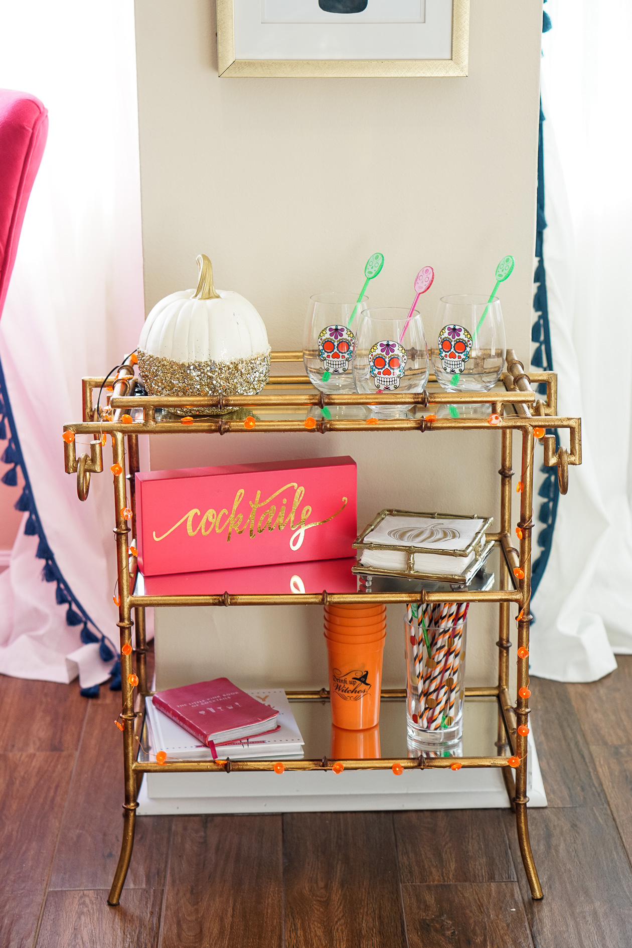 Halloween party gold bamboo bar cart with skull wine glasses