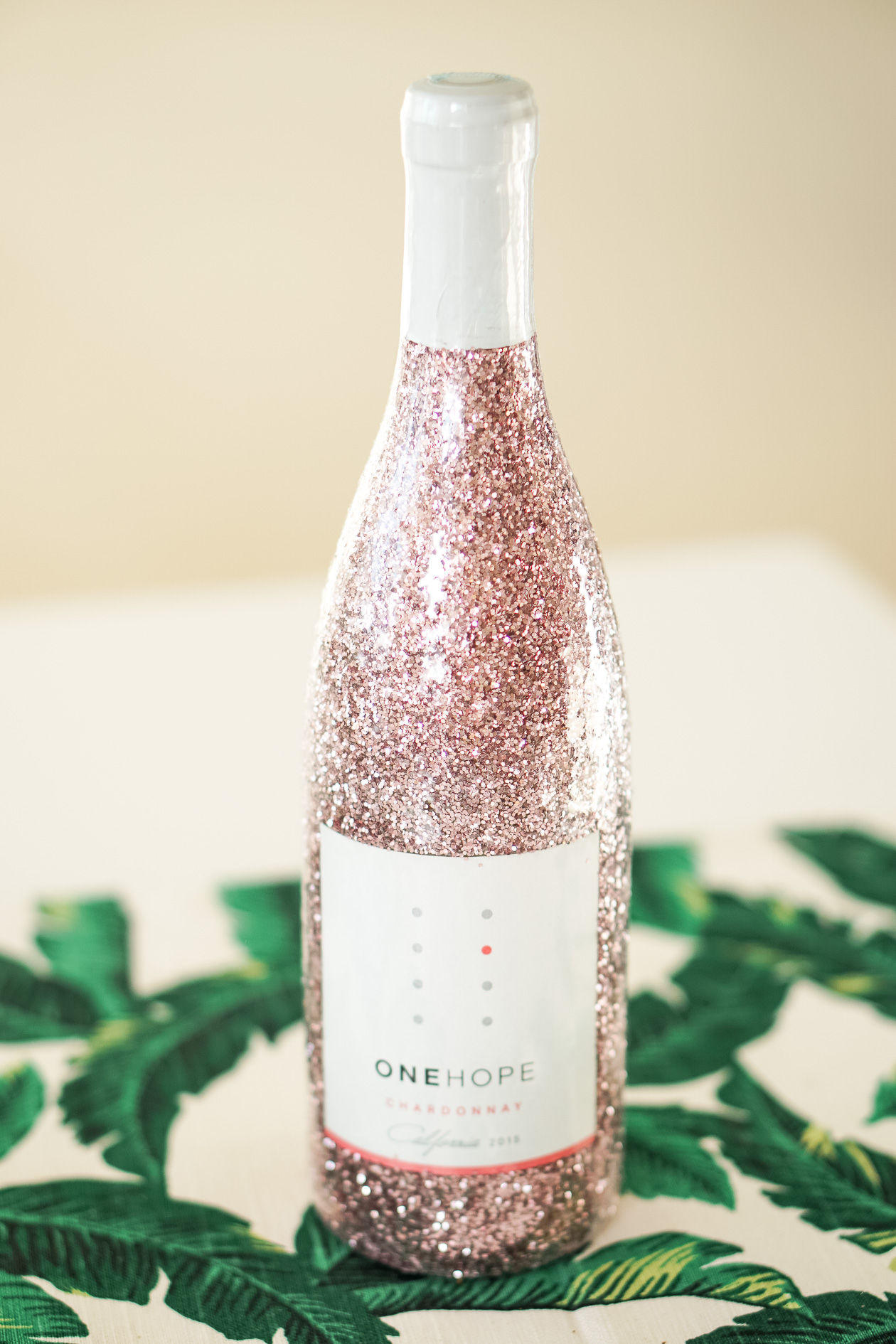 gifts for the post graduate Capri Blue candle and sequin wine bag
