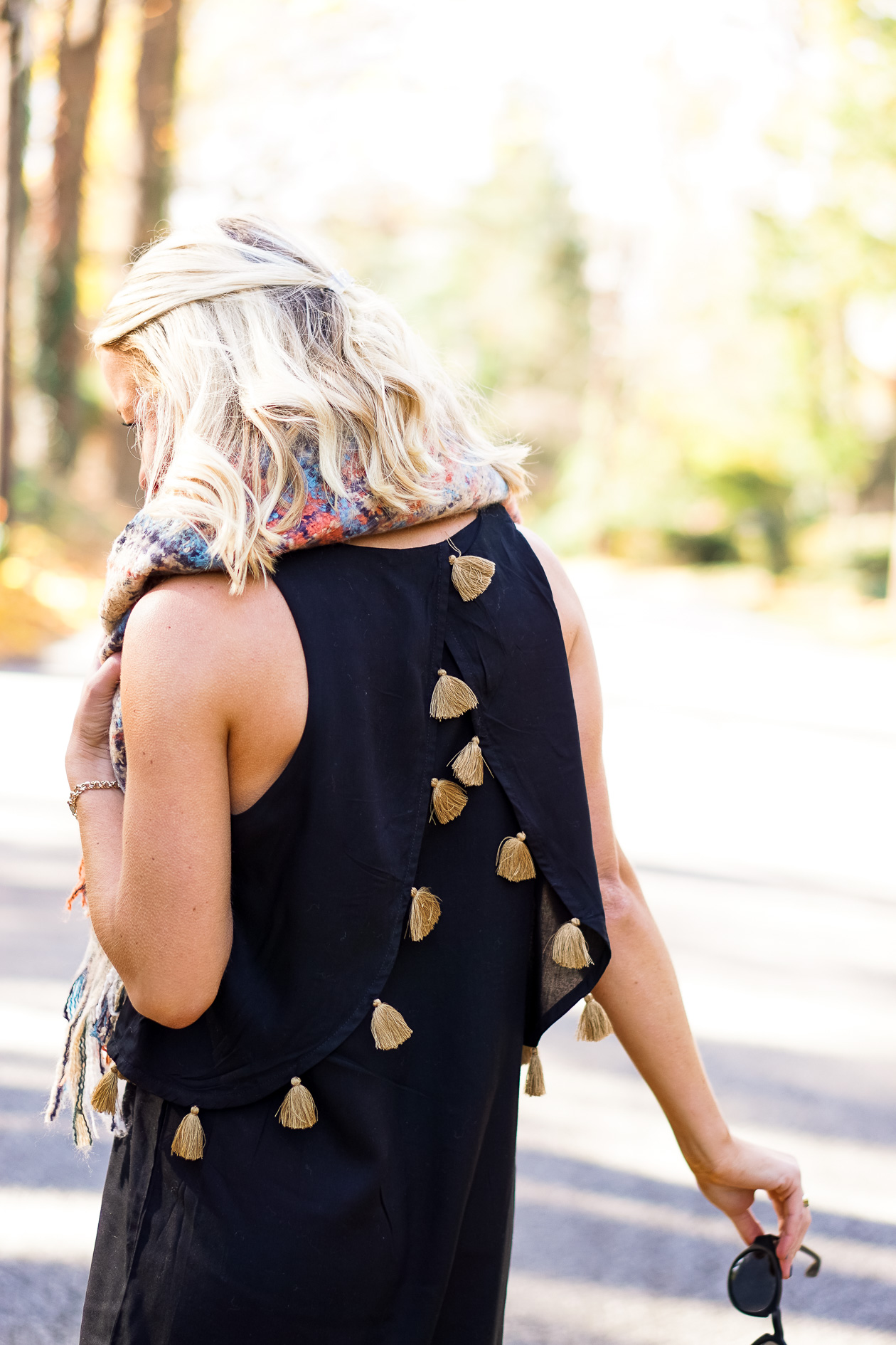 Black dress with gold tassels and blanket scar