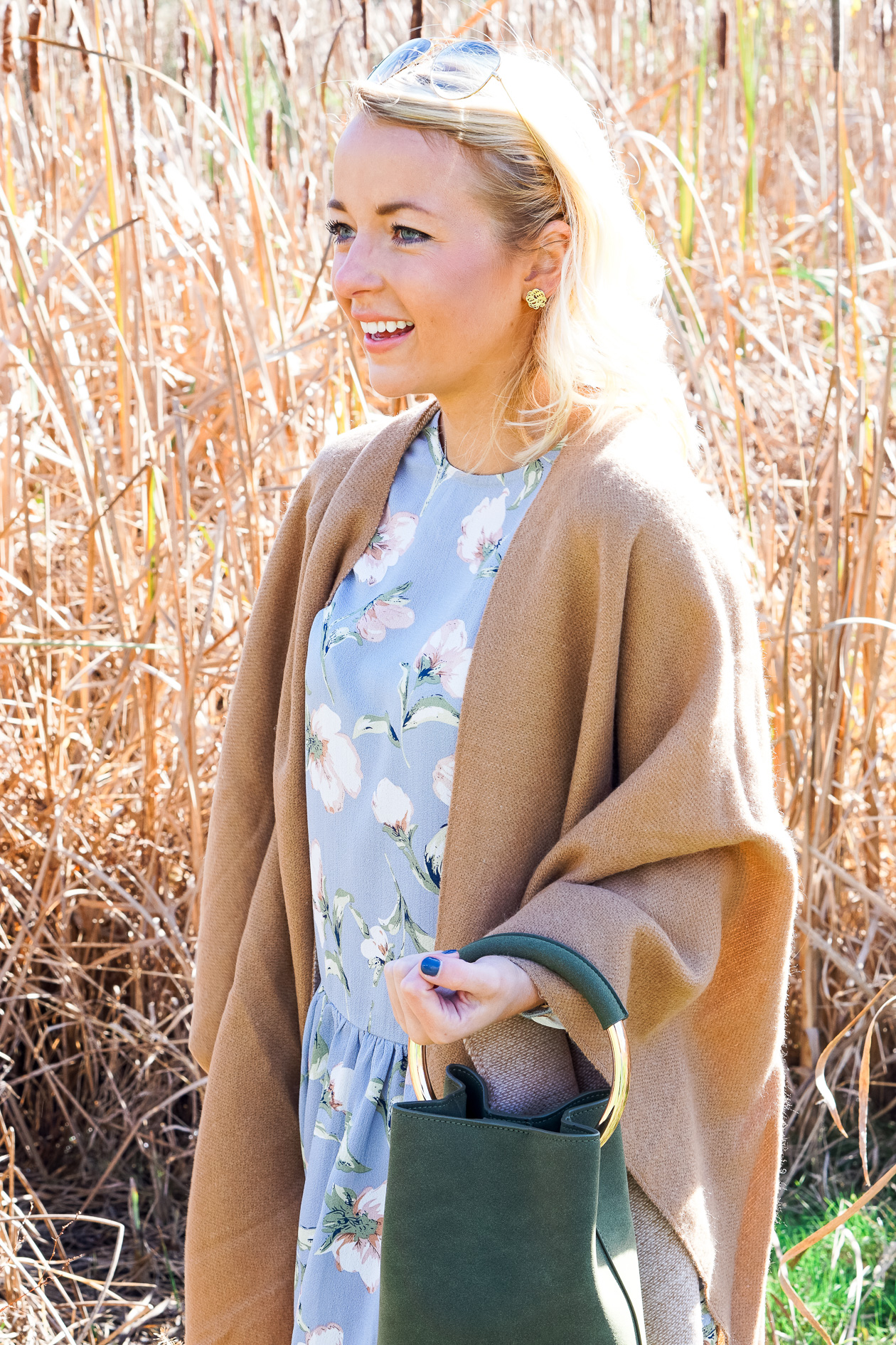 Camel tassel poncho and blue floral dress for Thanksgiving outfit
