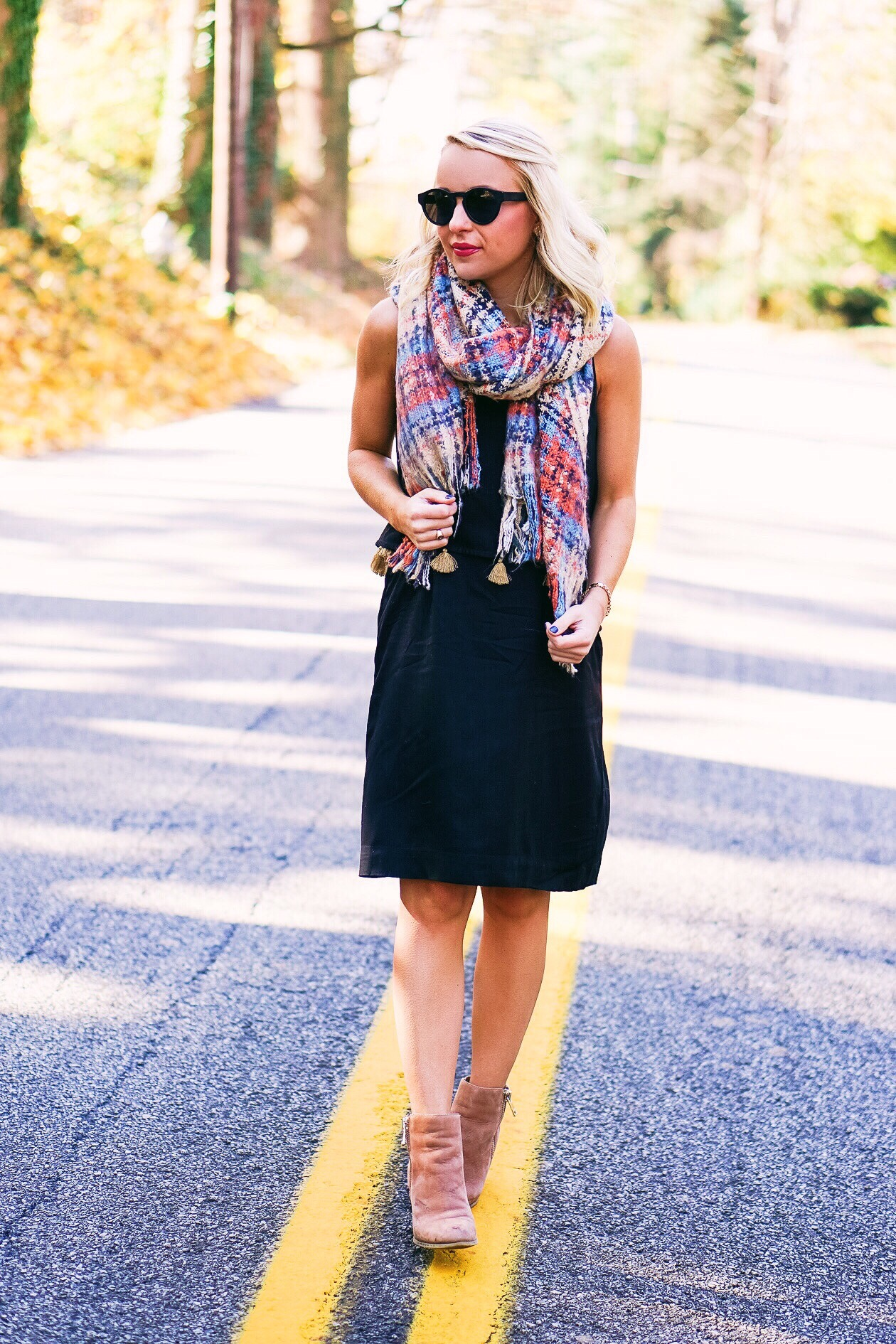 Black dress with gold tassels and blanket scarf