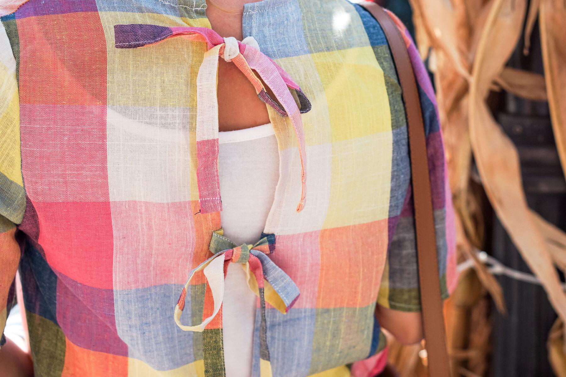 buffalo check bow top with brown tassel bucket bag