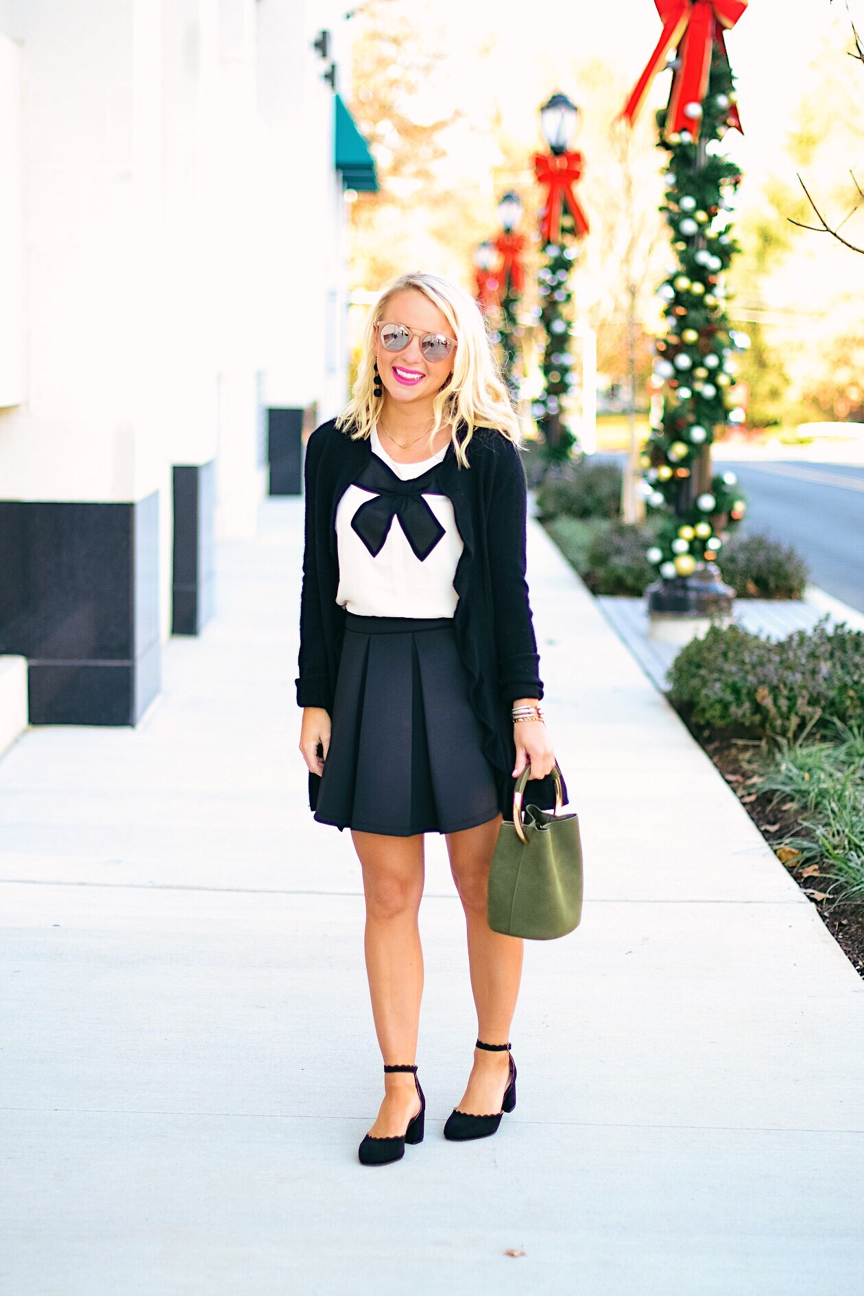 Bow top and black scalloped shoes