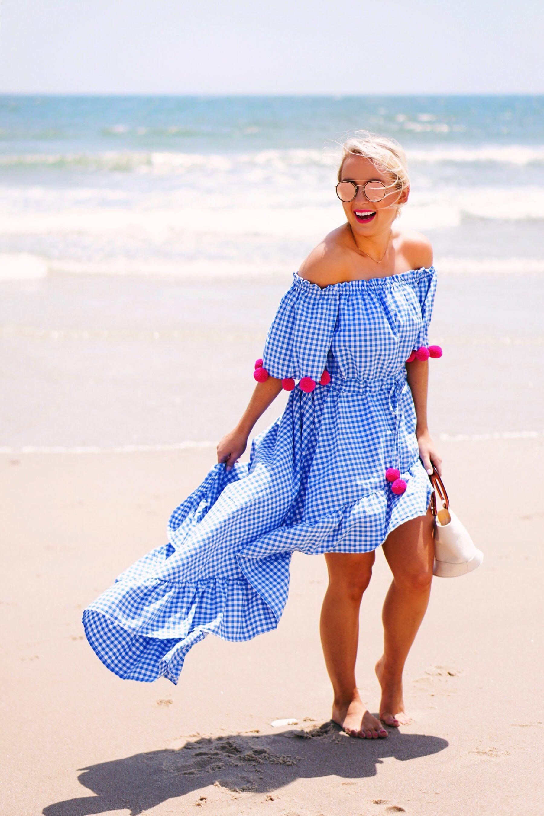 Blue gingham pom pom dress