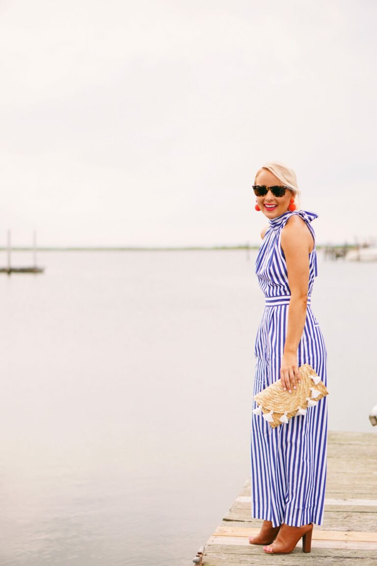 J. Crew striped jumpsuit with coral statement earrings and tassel clutch