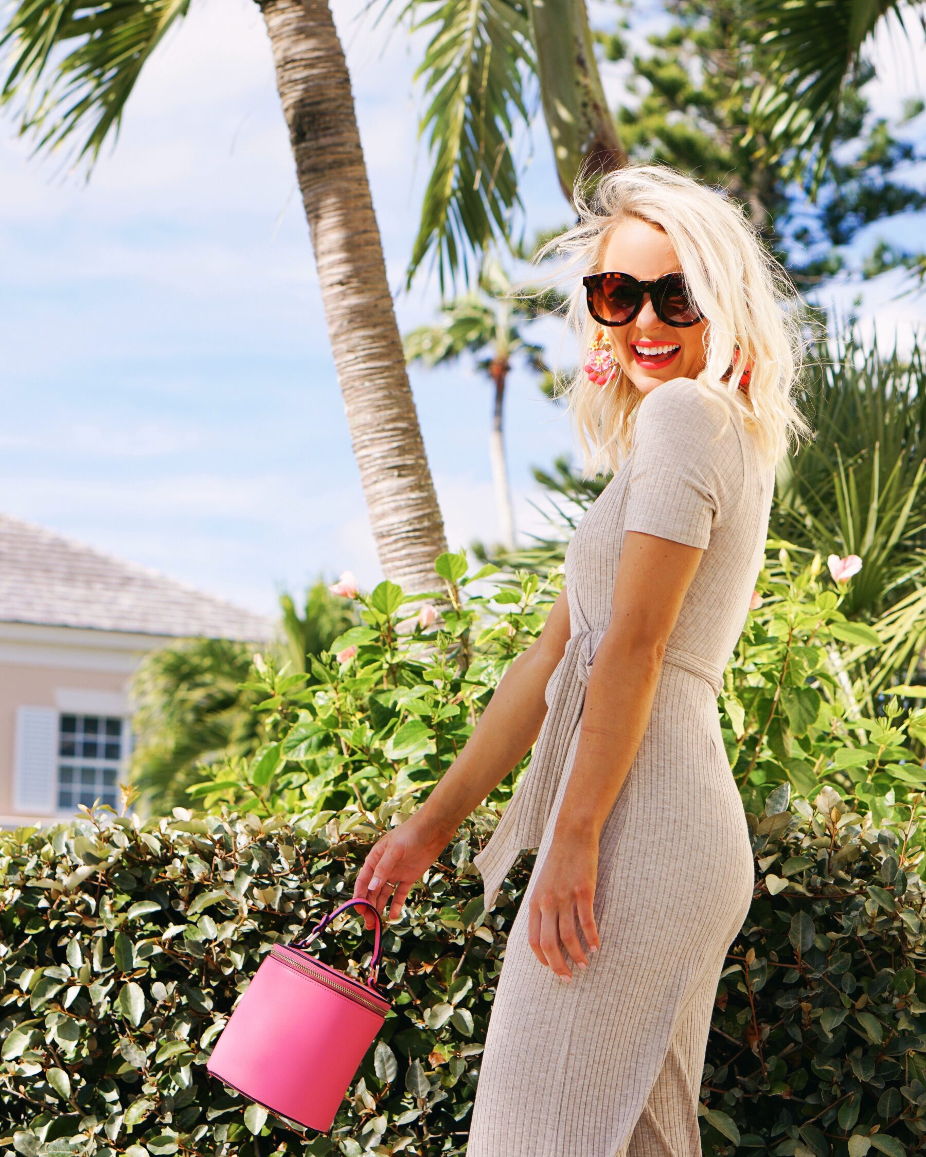 Francesca's jumpsuit and pink cylinder bag in Vero Beach, FL