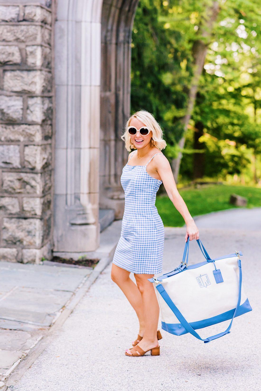 Memorial Day Weekend sales in a gingham dress and monogrammed weekender bag