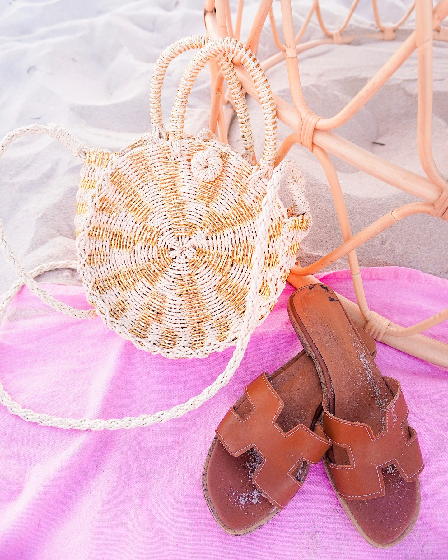 Gold straw bag and brown Hermes sandals
