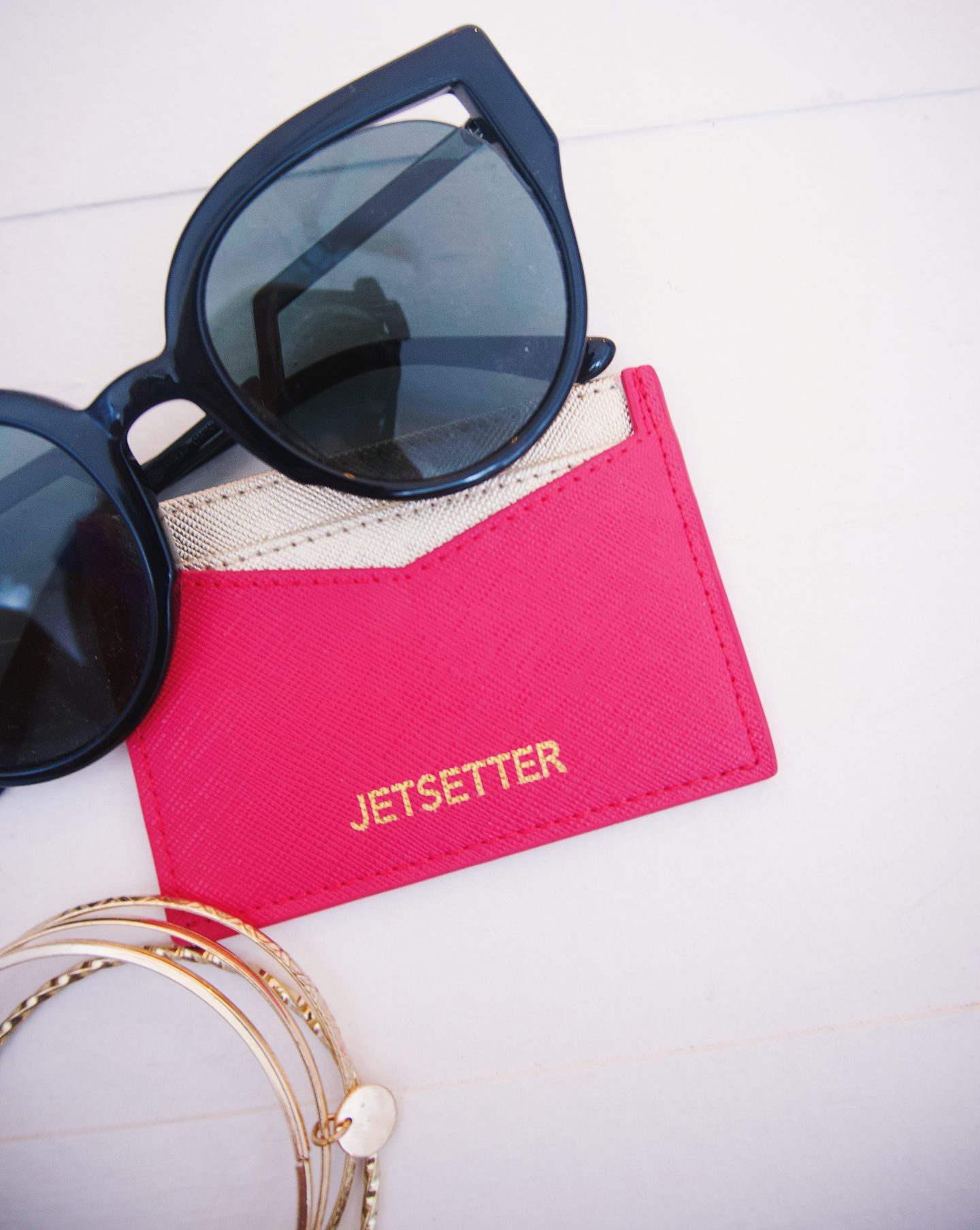 Jetsetter pink and gold card holder